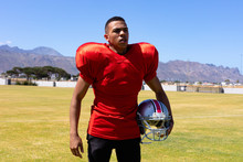 Football Player Carrying His Helmet