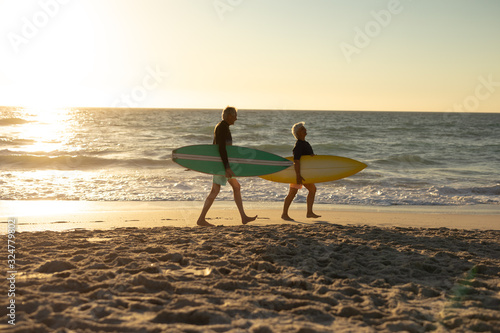 Old couple walking at the beach