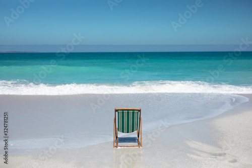 Chair in front of the waves