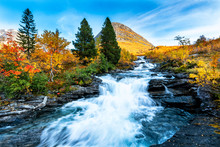 Beautiful Autumn Landscape With Yellow Trees And Waterfall