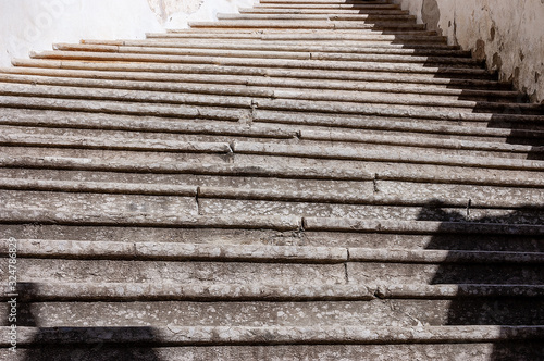 Closeup of a staircase with old stone steps - Background. Trentino Alto Adige, Italy, Europe