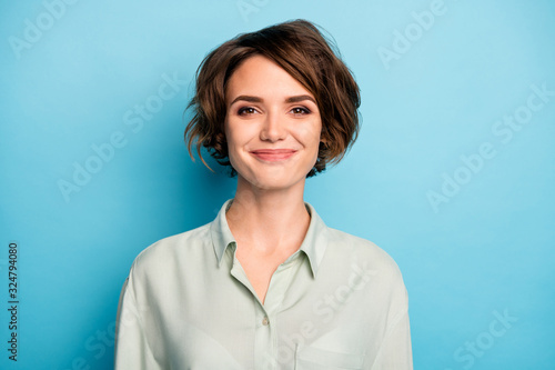 Fototapeta Closeup photo of attractive cute business lady short bob hairstyle smiling good mood responsible person wear casual formalwear green shirt isolated blue color background obraz