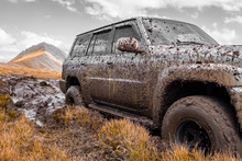 Adventure Travel Concept Background. 4x4 Off-road Suv Car Stuck In Mud. Adventure Travel Concept Background. Offroad Car.