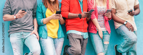 Young friends looking smart phones - Mixed race people using mobile phone with b Fototapete