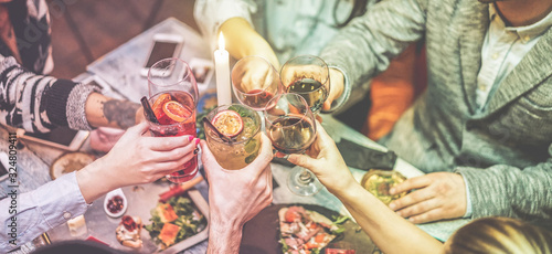 Photographie Group of trendy friends enjoying appetizer in speakeasy vintage bar - Young peop