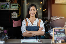 Asian Women Barista Smiling An...