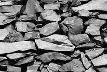 Basalt Stone Texture. Black And White Retro Style Photo.