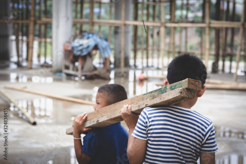 Photo Child labor, children are forced to work construction, Violence children and tra