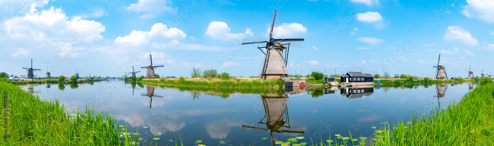 Fototapeta Panorama of the windmills and the reflection on water in Kinderdijk, a UNESCO World Heritage site in Rotterdam, Netherlands
