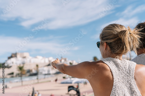 girl looking at peniscola city, in spain with copyspace