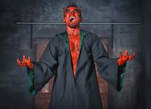 Terrible Devil Man Screaming. Scary Halloween Scene