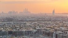 Dubai Skyline With Dubai Marina Skyscrapers And Coastline At Sunset Timelapse With Seven Star Luxury Hotel In Dubai, UAE.
