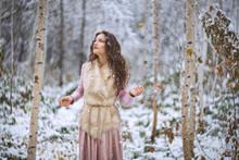 Girl Walks In A Winter Forest
