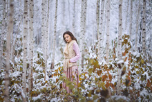 Girl Walks In A Winter Forest