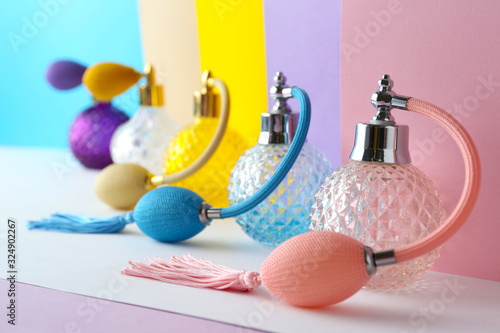 Composition with different bottles of perfume on color background, closeup Wallpaper Mural