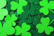Leinwanddruck Bild - Green clover leaves as background, top view. St. Patrick's Day celebration