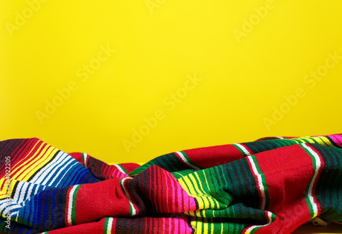 Colorful Mexican serape blanket on a yellow background Wallpaper Mural