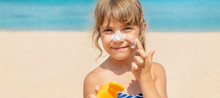 Sunscreen On The Skin Of A Child. Selective Focus.