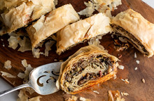 Close Up Of Mushroom And Wild Rice Strudel On Cutting Board