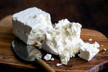 Feta Cheese Placed On Wooden B...