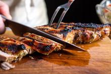 Close Up View Of Slicing Pork