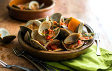 Close Up View Of Steamed Clams Served In Bowl