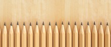 Natural Wood Pencils Sharpened In A Row. Wooden Background.