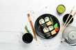 Traditional Sushi - Black and White, with crab, cheese and herbs. Japanese cuisine. Top view.