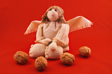 Angels With Walnuts On A Red Background