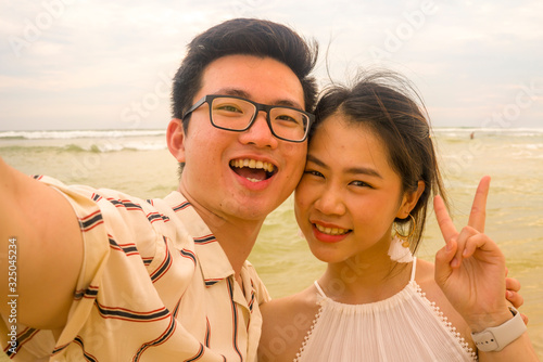 young happy and romantic Asian Korean couple in love enjoying holiday taking sel Canvas Print