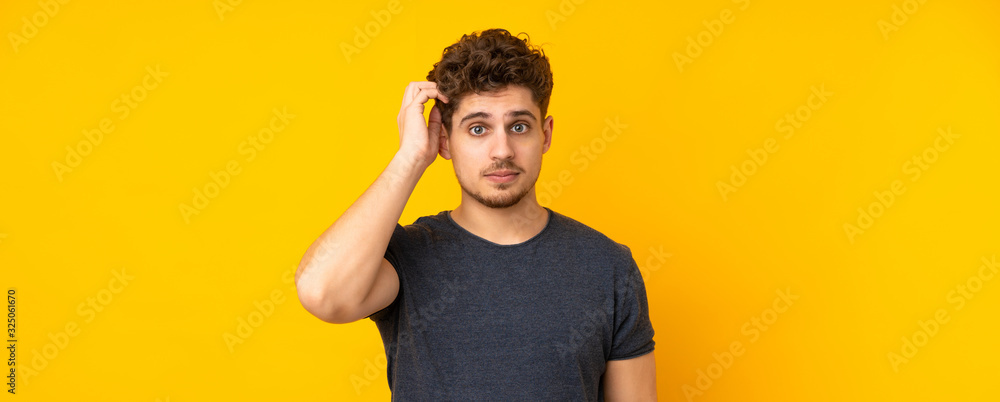 Fototapeta Young caucasian man isolated background with an expression of frustration and not understanding