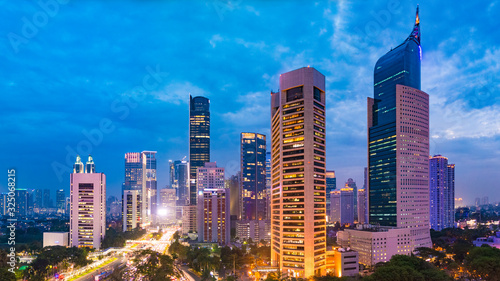 Aerial view of Jakarta's Central Business District at dusk (blue hour). Jakarta cityscape at sunset. Central Jakarta nightlife.