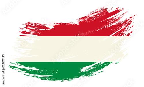 Leinwand Poster Hungarian flag grunge brush background. Vector illustration.