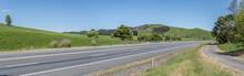 Highway 2 In Green Countryside Near Waitakaruru, New Zealand