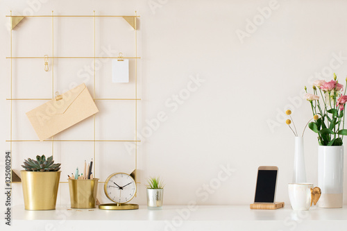 Modern office desk with gold accessories Wallpaper Mural
