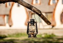 Old Lantern Hanging On Branch