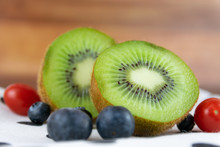 Delicious And Healthy Kiwi And Pineapple Fruit On Wooden Background.