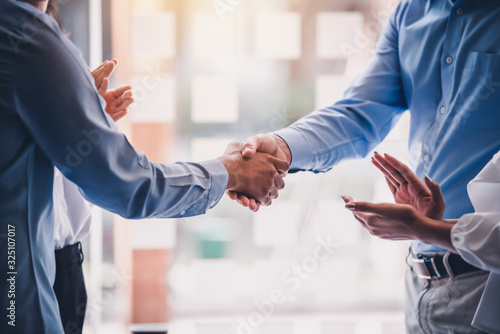 Fototapeta Business success. Businessman shaking hands agreement confirmed in the investment business. obraz