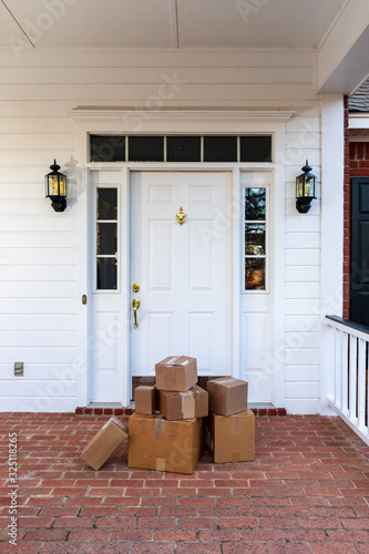 Valokuva Shipping boxes on front porch of home