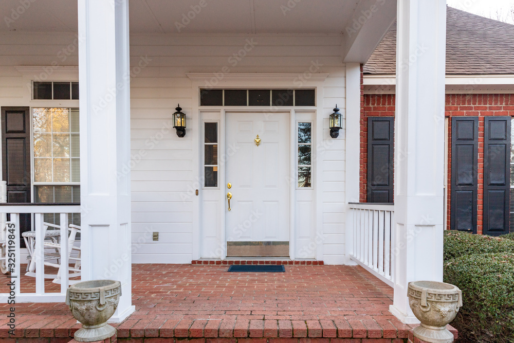 Fototapeta Front door and porch of a residential home