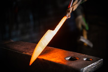 Forging A Knife Out Of The Hot Metal - Holding The Knife In Forceps