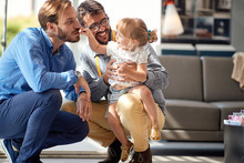 Gay Parents With Child In Stor...