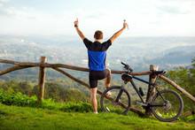 Happy Man Biker Raised Hands U...