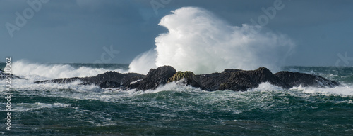 Massive waves crash over the rocks at Ballintoy Harbour, Causeway Coast, Norther Canvas Print