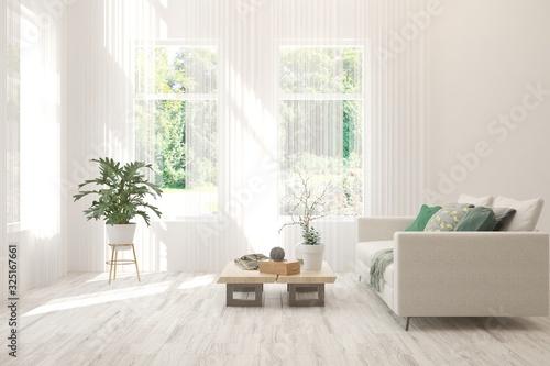 Obraz Minimalist living room in white color with sofa and summer landscape in window. Scandinavian interior design. 3D illustration - fototapety do salonu