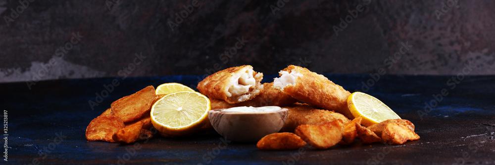 Obraz traditional British fish and chips consisting of fried fish, potato chips and mayonnaise fototapeta, plakat