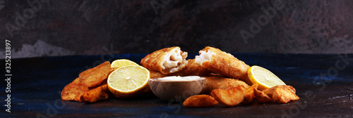 Fototapeta traditional British fish and chips consisting of fried fish, potato chips and mayonnaise obraz