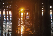 Under The Pier At Sunset