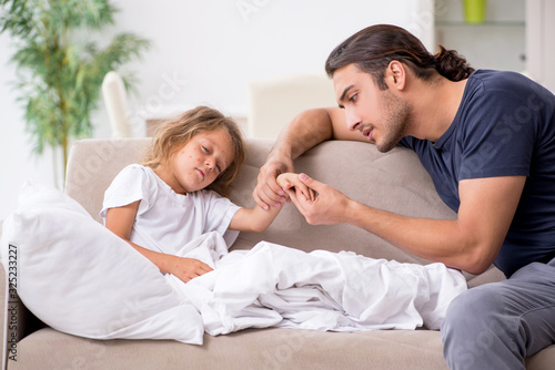 Father taking care of his ill daughter Canvas Print