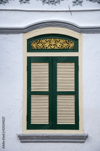 Window with the wooden carved architrave Wallpaper Mural
